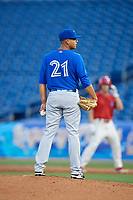 Dunedin Blue Jays relief pitcher Juliandry Higuera (21) looks in for the sign during a game against the Clearwater Threshers on April 6, 2018 at Spectrum Field in Clearwater, Florida.  Clearwater defeated Dunedin 8-0.  (Mike Janes/Four Seam Images)