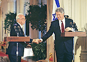 United States President Bill Clinton and Prime Minister Yitzhak Rabin of Israel shake hands after conducting a joint press conference in the East Room of the White House in Washington, DC on March 15, 1993.<br /> Credit: Ron Sachs / CNP