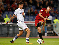 Calcio, Serie A: Roma vs Crotone. Roma, stadio Olimpico, 25 ottobre 2017.<br /> Roma's Edin Dzeko, right, kicks the ball as he is challenged by Crotone's Federico Ceccherini during the Italian Serie A football match between Roma and Crotone at Rome's Olympic stadium, 25 October 2017.<br /> UPDATE IMAGES PRESS/Riccardo De Luca