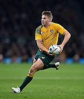 Drew Mitchell of Australia looks to pass the ball. Rugby World Cup Final between New Zealand and Australia on October 31, 2015 at Twickenham Stadium in London, England. Photo by: Patrick Khachfe / Onside Images