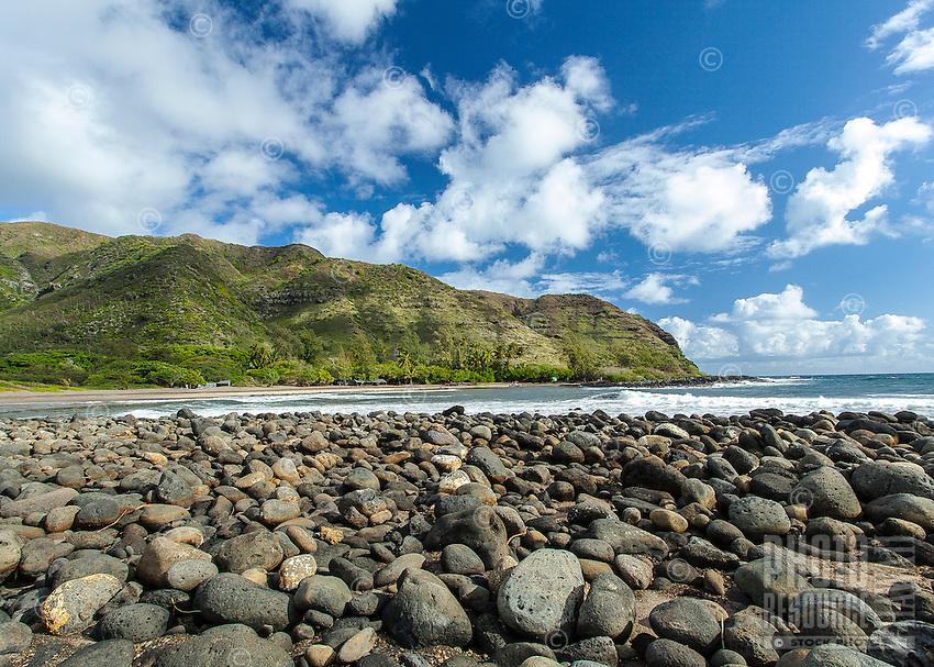 Mountain with a rocky shoreline in Halawa Valley on Moloka'i
