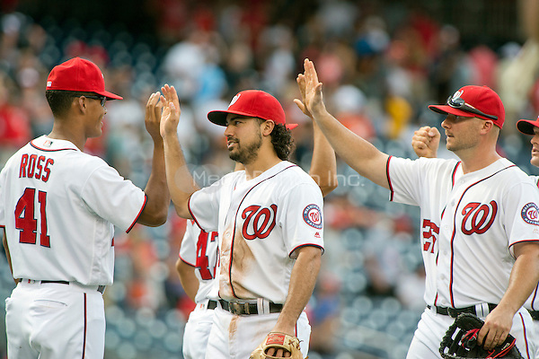 Washington Nationals starting pitcher Joe Ross (41), third baseman Anthony Rendon (6), and first baseman Clint Robinson (25) celebrate their team's 9 - 1 victory over the Atlanta Braves at Nationals Park in Washington, D.C. on Sunday, August 14, 2016.  The Nationals won the game 9 - 1.<br /> Credit: Ron Sachs / CNP/MediaPunch ***FOR EDITORIAL USE ONLY***