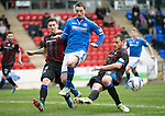 St Johnstone v Inverness Caledonian Thistle....22.02.14    SPFL<br /> Gary McDonald is closed out by Gary Warren and Josh Meekings<br /> Picture by Graeme Hart.<br /> Copyright Perthshire Picture Agency<br /> Tel: 01738 623350  Mobile: 07990 594431