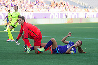 Orlando, Florida - Sunday, May 8, 2016: Seattle Reign FC goalkeeper Hope Solo (1) collides with Orlando Pride forward Alex Morgan (13) during a National Women's Soccer League match between Orlando Pride and Seattle Reign FC at Camping World Stadium.