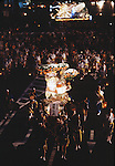 As darkness falls on Aomori huge illuminated paper-mache floats made of lumber, bamboo, wire and paper depicting men, animals and birds are pushed and pulled through the streets by groups of men, women and children during the Nebuta Festival in Aomori, Japan.  The festival dates back to the beginning of the eight century when the Ezo residents in northern Honshu rose in revolt. The Emperor sent General Sakanoue-no-Tamramaro, who, built Nebuta dummies of men and horses which were floated away at night. The Ezo thinking the Imperial troops had withdrawn, came back into the city only to be slaughtered by troops waiting in secret. Themes of the floats are picked from Kabuki stages, historical characters or fairy tales. (Jim Bryant Photo).....