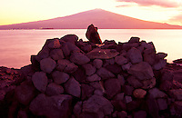 Fishing shrine on the coast of Kahoolawe with majestic Haleakala on Maui in background.
