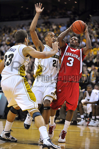 Jan 23, 2010; Columbia, MO, USA; Nebraska Cornhuskers guard Brandon Richardson (3) goes up for a shot as Missouri Tigers forward Laurence Bowers (21) and forward Justin Safford (23) provide coverage in the first half at Mizzou Arena in Columbia, MO. Missouri won 70-53. Mandatory Credit: Denny Medley-US PRESSWIRE