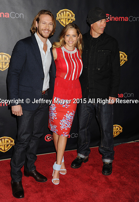 LAS VEGAS, CA - APRIL 21: (L-R) Actors Luke Bracey, Teresa Palmer and director Ericson Core arrive at Warner Bros. Pictures Invites You to ?The Big Picture at The Colosseum at Caesars Palace during CinemaCon, the official convention of the National Association of Theatre Owners, on April 21, 2015 in Las Vegas, Nevada.