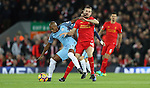 Fernandinho of Manchester City and Jordan Henderson of Liverpool during the English Premier League match at Anfield Stadium, Liverpool. Picture date: December 31st, 2016. Photo credit should read: Lynne Cameron/Sportimage