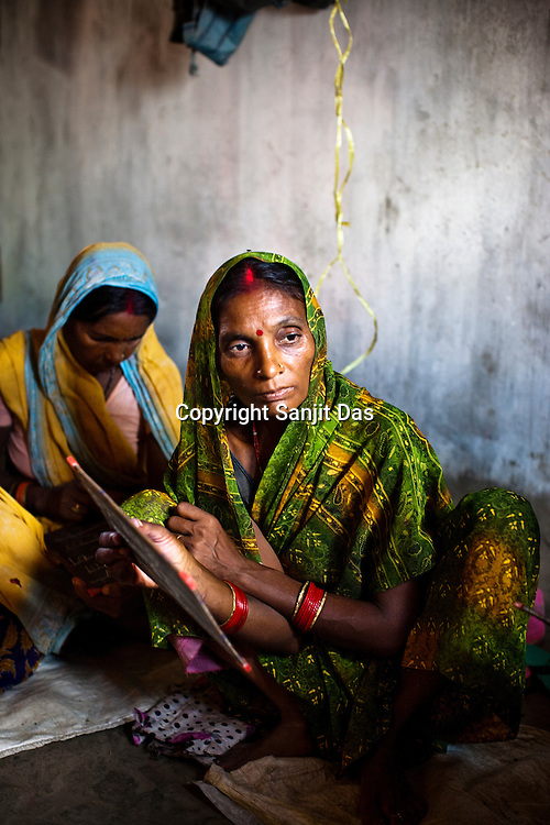 Manjali Devi, one of the local village women is seen attending the SHG (self help group) literacy programme organised by the Fakirana Sisters Society in Vishambarpur Village, in Bettiah of West Champaran district in Bihar. Since 2008 the Foundation and Geneva Global have been investing in the training of medical staff to improve the lives of people living in 600+ villages in the region. The NGOs are delivering cost effective interventions to address treatment, care and prevention of diseases, disability and preventable deaths amongst infants, adolescent girls and women of child-bearing age. There is statistical and anecdotal evidence that there have been vast improvements and a total of 40-50% increased immunization for all children under 6 has meant that communities can be serviced and educated long term. Photograph: Sanjit Das/Panos for Legatum Foundation
