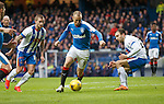 Kenny Miller goes past Conrad Balatoni