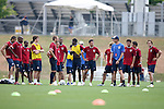 Trainer Pierre Barrieu (in ballcap at right) explains an conditioning exercise to the team on Sunday, May 14th, 2006 at SAS Soccer Park in Cary, North Carolina. The United States Men's National Soccer Team held a training session as part of their preparations for the upcoming 2006 FIFA World Cup Finals being held in Germany.