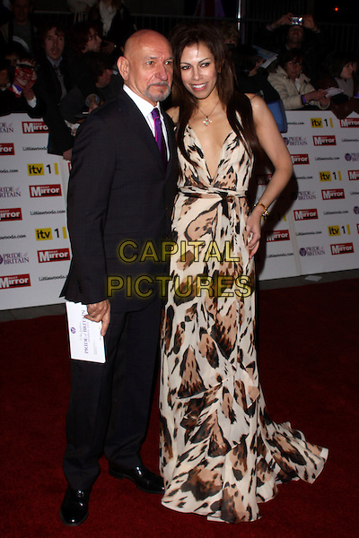 SIR BEN KINGSLEY & DANIELA LAVENDER.The Pride of Britain Awards 2010, Grosvenor House, Park Lane, London, England, UK..November 8th 2010.arrivals full length black suit dress brown beige leopard print married husband wife maxi plunging neckline purple tie goatee facial hair .CAP/AH.©Adam Houghton/Capital Pictures.