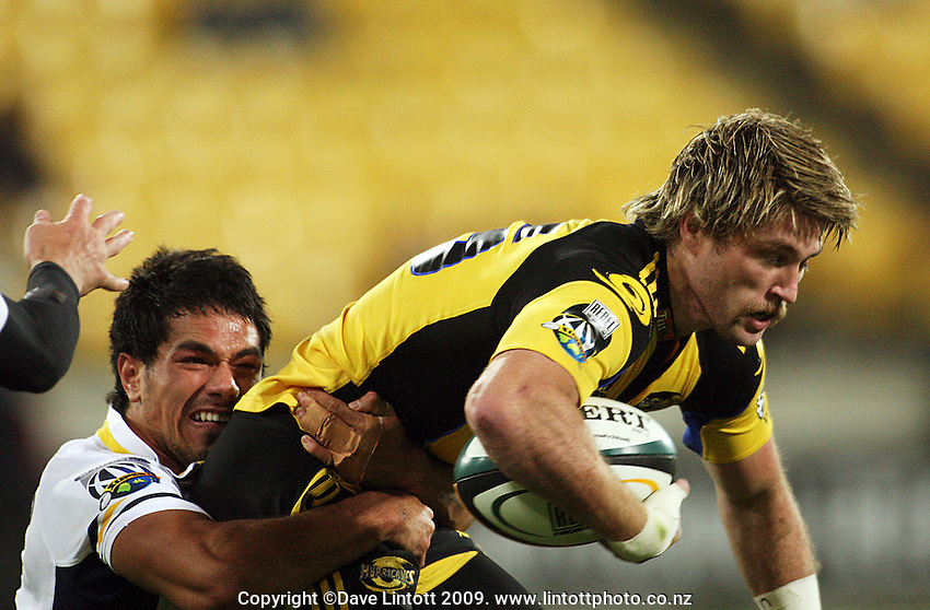 Brumbies winger Alfi Mafi tries to tackle Cory Jane during the Super 14 rugby union match between the Hurricanes and Brumbies at Westpac Stadium, Wellington, New Zealand. Saturday 25 April 2009. Photo: Dave Lintott / lintottphoto.co.nz