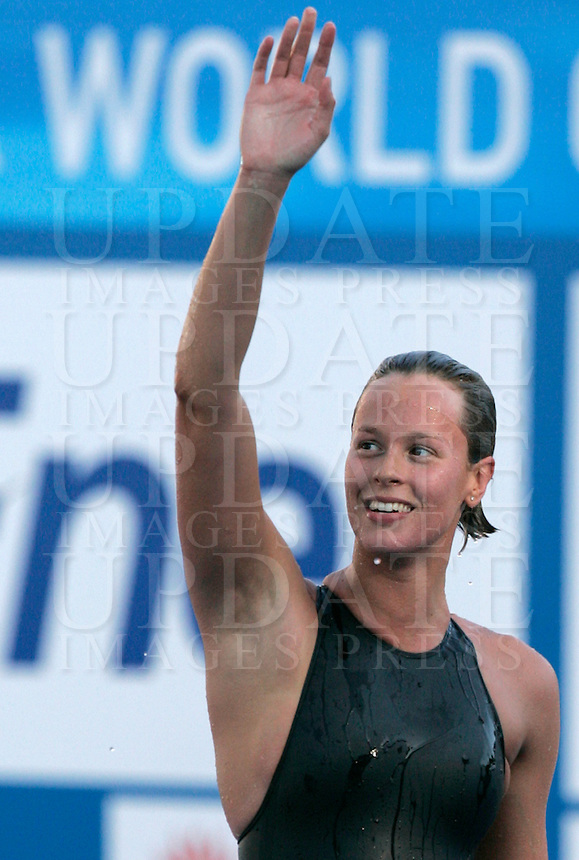 Italy's Federica Pellegrini waves to fans after setting the new world record clocking 1.52.98 in the Women's 200m Freestyle, at the Swimming World Championships in Rome, 29 July 2009..UPDATE IMAGES PRESS/Riccardo De Luca