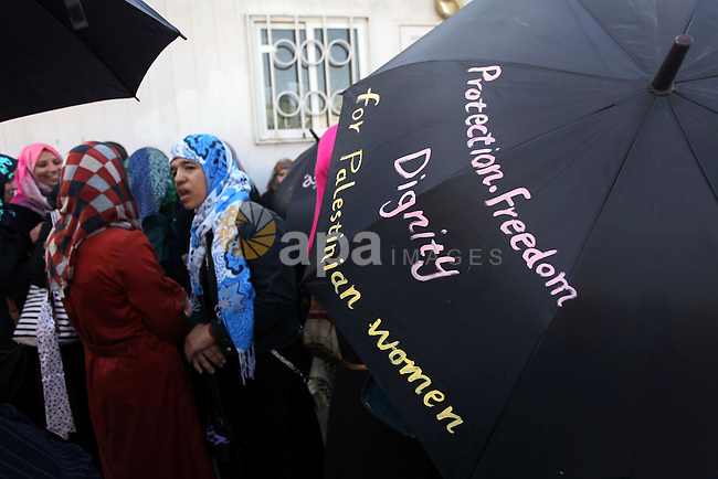 Palestinian women take part in a demonstration to mark the International Day of Human Rights, in Gaza City on December 10, 2014. The Palestinians are seeking a UN resolution by year-end that would set a timetable for Israel's withdrawal from occupied Palestinian territory, chief negotiator Saeb Erakat said. Photo by Ashraf Amra