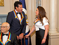Lionel Richie and Gloria Estefan, two of the five recipients of the 40th Annual Kennedy Center Honors, converse after posing for a group photo following a dinner hosted by United States Secretary of State Rex Tillerson in their honor at the US Department of State in Washington, D.C. on Saturday, December 2, 2017.  Norman Lear can be seen at the lower left corner. The 2017 honorees are: American dancer and choreographer Carmen de Lavallade; Cuban American singer-songwriter and actress Gloria Estefan; American hip hop artist and entertainment icon LL COOL J; American television writer and producer Norman Lear; and American musician and record producer Lionel Richie. Photo Credit: Ron Sachs/CNP/AdMedia