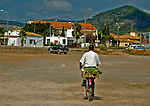 Man on bike with produce in ibiza spain
