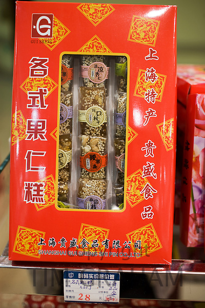 Box of Chinese sweets with nuts and sesame seeds on sale in souvenir shop, Shanghai, China
