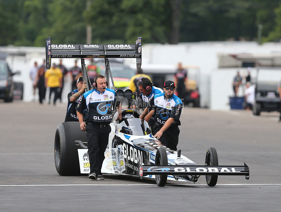 Aug 18, 2017; Brainerd, MN, USA; Crew members for NHRA top fuel driver Shawn Langdon during qualifying for the Lucas Oil Nationals at Brainerd International Raceway. Mandatory Credit: Mark J. Rebilas-USA TODAY Sports