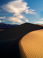 Clouds and sand dunes in Death Valley National Park, California