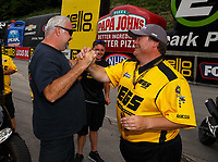 Jun 18, 2017; Bristol, TN, USA; NHRA pro mod driver Troy Coughlin Sr (right) celebrates with crew chief Steve Petty after winning the Thunder Valley Nationals at Bristol Dragway. Mandatory Credit: Mark J. Rebilas-USA TODAY Sports