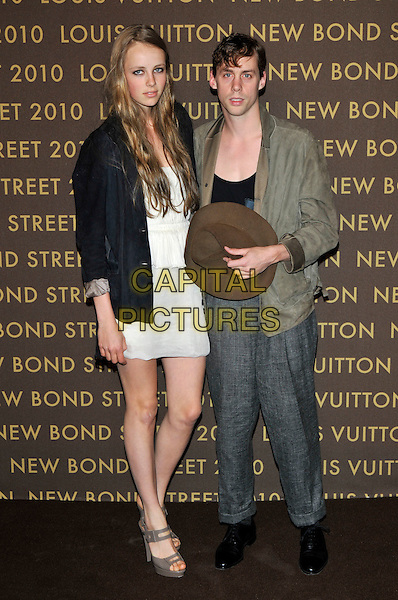 GUEST & JOHNNY BORRELL.attending the launch of the Louis Vuitton Bond Street Maison in London, England, UK, May 25th, 2010..full length grey gray tweed trousers loose baggy green khaki jacket black t-shirt holding hat white dress top skirt blazer .CAP/PL.©Phil Loftus/Capital Pictures.