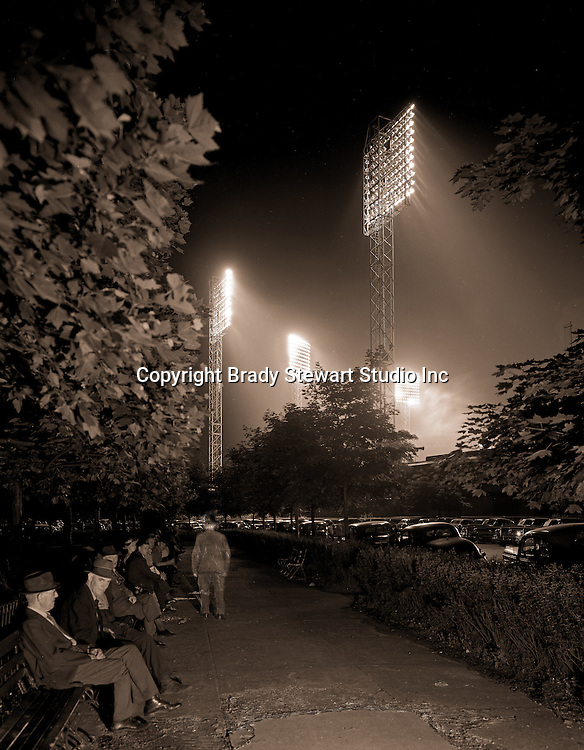 Pittsburgh PA:  During the depression, homeless men used to meet behind Forbes Field in Schenley Park during baseball games. They would listen to the game and talk with their friends - the Oakland section of Pittsburgh 1936