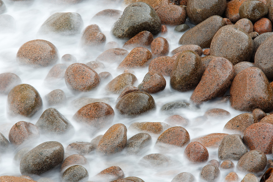Water washing over round cobbles, Boulder Beach, Monument Cove, Acadia National Park, Maine, USA