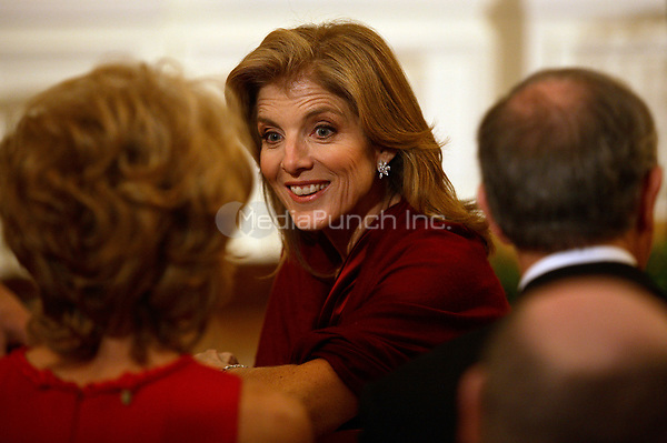Washington, DC - December 6, 2009 -- Caroline Kennedy chats with guests at a White House East Room reception for the recipients of the 2009 Kennedy Center Honors, Sunday, December 6, 2009. <br /> Credit: Martin H. Simon / Pool via CNP /MediaPunch