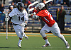 Chris Bacotti #14 of Massapequa, left, gets pressured by Luke Eschbach #21 of Smithtown East during a non-league varsity boys lacrosse game at Burns Park on Saturday, Mar. 26, 2016. Smithtown East won by a score of 17-16.