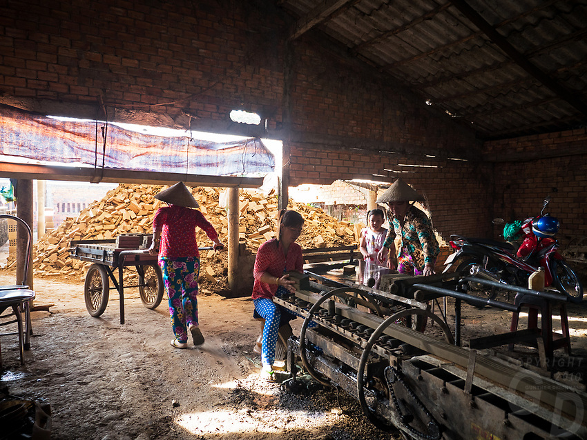 Women preparing the wet Bricks for the Kiln. The Brick production and Kiln of Vinh Long in the Mekong Delta, Vietnam.