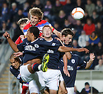 Nikica Jelavic beats five Falkirk players in the box to direct a header towards goal