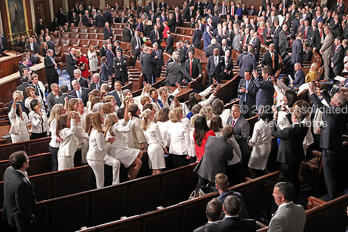 Democratic women wearing white in response to Representative Lois Frankel's call to acknowledge the voters who handed Democrats a majority in the House in the midterm elections and a reminder that they plan to make women's economic security a priority prior to US President Donald J. Trump delivers his second annual State of the Union Address to a joint session of the US Congress in the US Capitol in Washington, DC on Tuesday, February 5, 2019.<br /> Credit: Alex Edelman / CNP