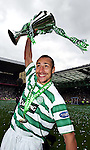 2ND MAY 2004, Celtic v Dunfermline, SPL match at Celtic Park, Glasgow, Henrik Larsson holds aloft the SPL Trophy as Celtic with the title, Rob Casey Photography.