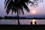 CAMBODIA  -  APRIL 4, 2005:  The sun sets on the bank of the Kampot River in Kampot on April 4th, 2005 in Cambodia.  (PHOTOGRAPH BY MICHAEL NAGLE) .