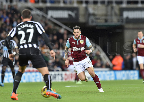 01.01.2015.  Newcastle, England. Barclays Premier League. Newcastle versus Burnley. Danny Ings of Burnley closes down Steven Taylor of Newcastle United