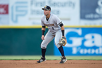 Charleston RiverDogs second baseman Vicente Conde (4) on defense against the Hickory Crawdads at L.P. Frans Stadium on August 25, 2015 in Hickory, North Carolina.  The Crawdads defeated the RiverDogs 7-4.  (Brian Westerholt/Four Seam Images)