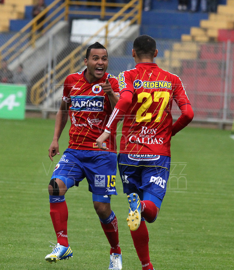 PASTO - COLOMBIA -30-03-2013: Anthony Tapia (Izq.) y Luis Páez (Der.) jugadores del Deportivo Pasto celebran el gol anotado al Deportivo Independiente Medellín, durante  partido por la Liga de Postobon I en el estadio La Libertad en la ciudad de Pasto, marzo 30 de 2013. (Foto: VizzorImage / Str). Anthony Tapia (L) and Luis Paez (R) players of Deportivo Pasto celebrate a goal scored against Deportivo Independiente Medellin, during a match for the Postobon I League at La Libertad stadium in Pasto city, on March 30, 2013, (Photo: VizzorImage / Str.)....