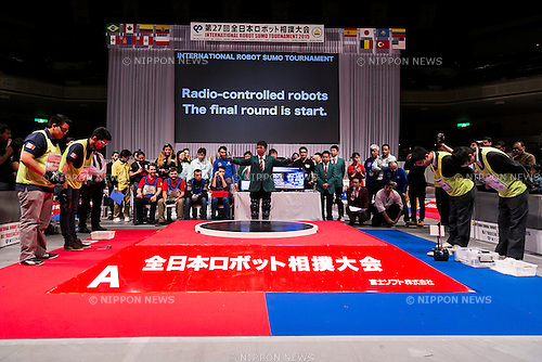 (L to R) Robot operators from Mexico and Japan greet each other at the final round of Radio-controlled robots category during the International Robot Sumo Tournament 2015, in the Ryogoku Sumo Hall (Ryogoku Kokugikan) on December 13, 2015. The annual competition brings the winners from 14 robot sumo tournaments held globally, plus the Japanese winners of the All Japan Robot-Sumo National Tournament and All Japan Robot-Sumo Tournament (High-School class) to fight for the world's first place in two divisions: autonomous and radio controlled. The international tournament is part of the All Japan Robot-Sumo Tournament which has been held in various countries since 1989. According to the rules the robot wrestler loses when the robot is forced outside the sumo ring, simulating a traditional sumo fight. (Photo by Rodrigo Reyes Marin/AFLO)