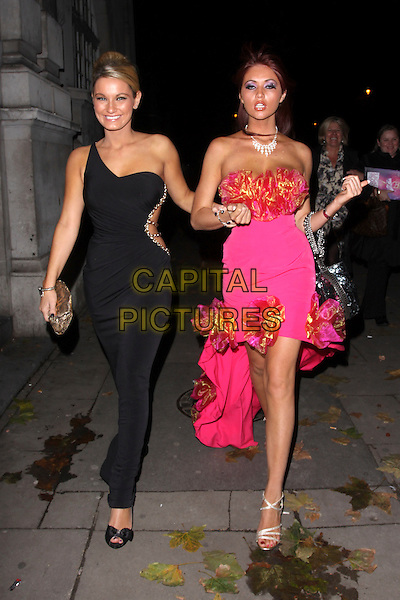 SAM FAIERS & AMY CHILDS .At the After Party for Legally Blonde The Musical, Opal nightclub, London, England, UK, November 9th 2010..full length black one shoulder dress long maxi cut out away side chains pink strapless corsages ruffle trim walking clutch bag .CAP/AH.©Adam Houghton/Capital Pictures.