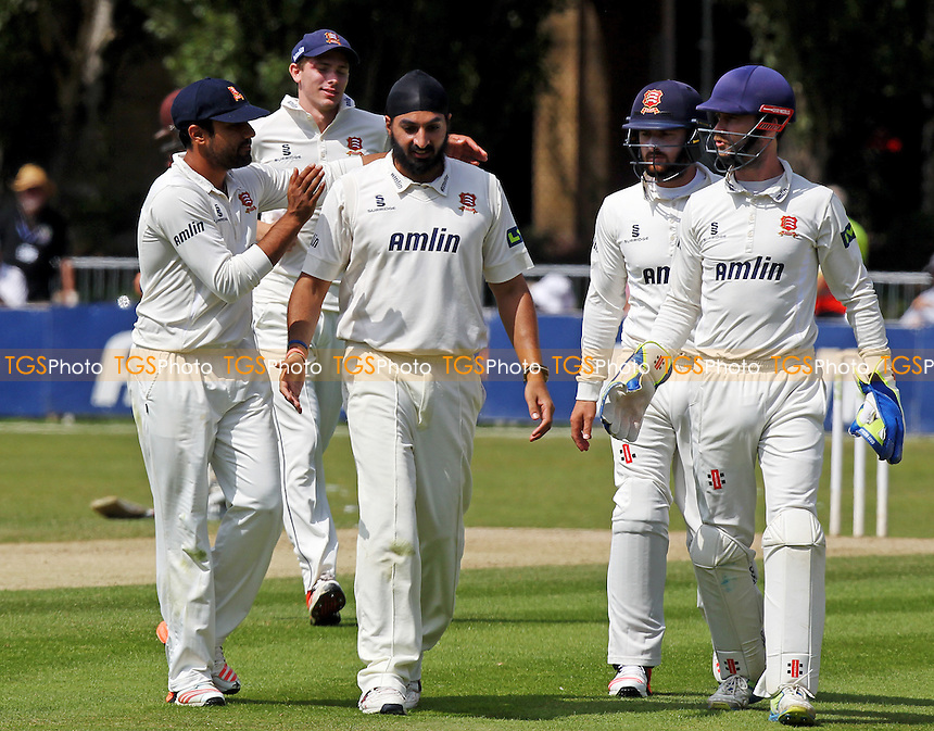 Monty Panesar celebrates taking the wicket of Arun Harinath with his Essex team-mates.