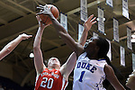 28 November 2014: Duke's Elizabeth Williams (1) blocks a shot by Stony Brook's Brittany Snow (20). The Duke University Blue Devils hosted the Stony Brook University Seahawks at Cameron Indoor Stadium in Durham, North Carolina in a 2014-15 NCAA Division I Women's Basketball game. Duke won the game 72-42.