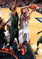 Virginia guard Joe Harris (12) shoots next to Miami guard Rion Brown (15) during an NCAA basketball game Saturday Feb, 24, 2014 in Charlottesville, VA. Virginia defeated Miami 65-40.
