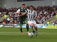 Paul McGowan chased by Paul Cairney in the St Mirren v Hibernian Clydesdale Bank Scottish Premier League match played at St Mirren Park, Paisley on 18.8.12.