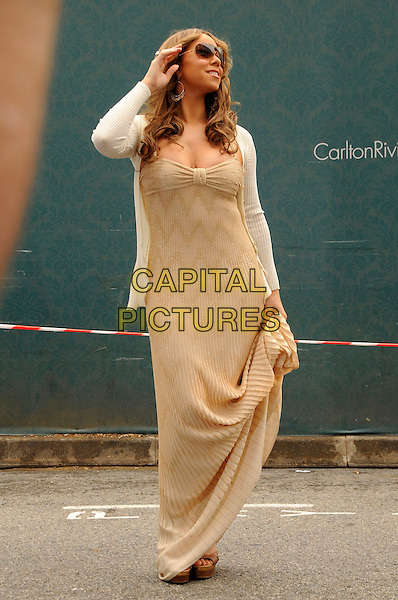 MARIAH CAREY.At the Hotel Martinez, Cannes, France..May 15th, 2009.full length long maxi dress beige white dress cardigan sunglasses shades hand gold.CAP/CAS.©Bob Cass/Capital Pictures.