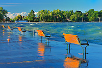 Benches on pier at sunrise with Lake Ontario at Port Dalhouise<br /> Ste Catharines<br /> Ontario<br /> Canada