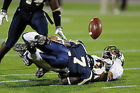 22 November 2008:  FIU defensive back Anthony Gaitor (7) tackles Louisiana-Monroe wide receiver Darrell McNeal (3) in the ULM 31-27 victory over FIU at FIU Stadium in Miami, Florida.