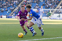 Stefan Scougall of Carlisle United marshalls Courtney Senior of Colchester United on the left wing during Colchester United vs Carlisle United, Sky Bet EFL League 2 Football at the JobServe Community Stadium on 23rd February 2019