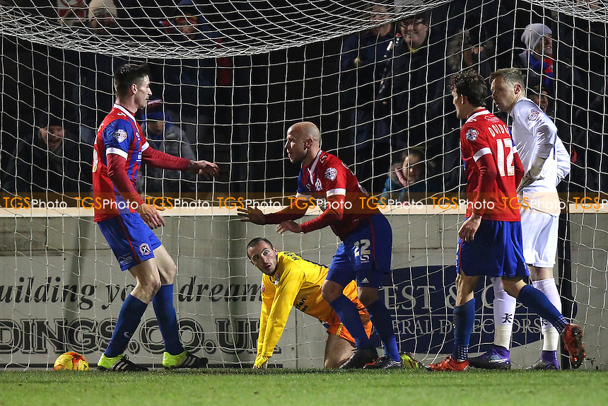 Luke Guttridge of Dagenham and Redbridge scores the first goal for his team and celebrates with his team mates during Dagenham and Redbridge vs Wycombe Wanderers, Sky Bet League 2 Football at the Chigwell Construction Stadium,